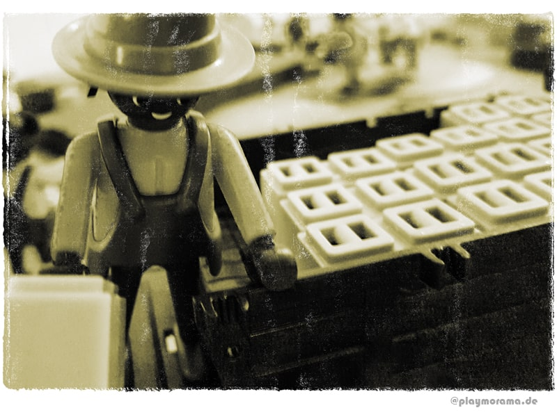 Ein Arbeiter beim Abladen der Kutsche