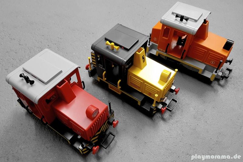Die drei Versionen der Playmobil Rangierlok. Die neuste Version fährt mit Akku und Fernbedienung