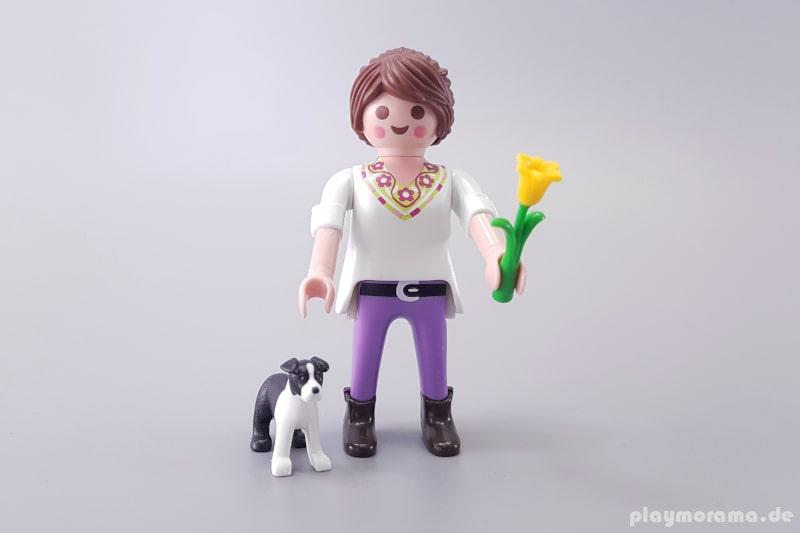 70371 - Frau mit Border Collieund Tulpe